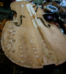 Patched soundboard of upright bass